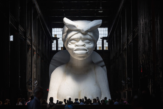 Large Scale Sugar-Coated Sculpture Displayed In Brooklyn's Former Domino Sugar Refinery